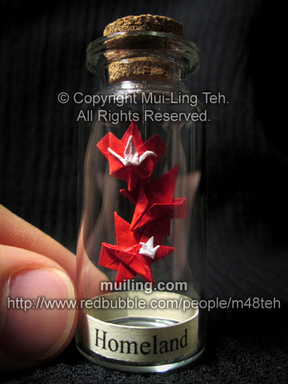 Miniature origami crane leaf, maple leaves, and crane in a bottle by Mui-Ling Teh